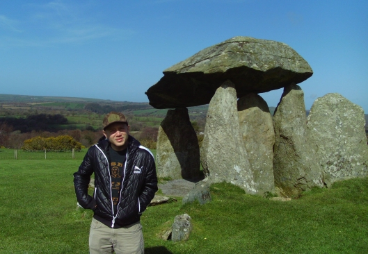A familiar face (not Sven) shows the size of one of the 3,000 year old megaliths that are still standing